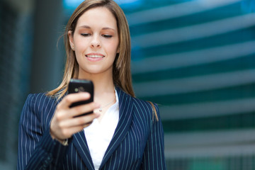 Businesswoman using her cell phone