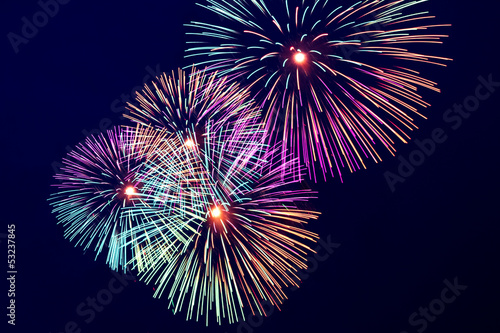 Colorful fireworks on the dark dlue sky background