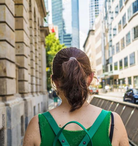 attractive woman on the sidewalk downtown Frankfurt