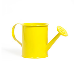 yellow watering can isolated on a white background