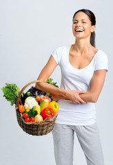 Happy healthy woman with vegetables