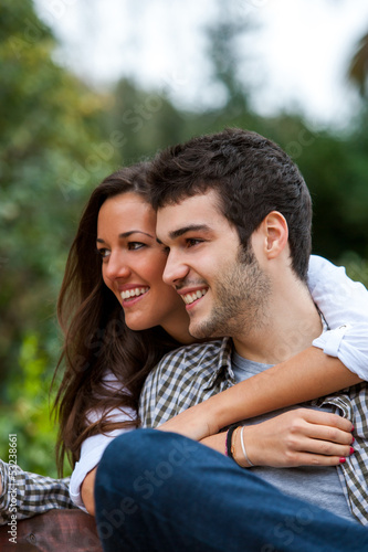 Couple in park embracing.