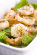 Fresh grilled shrimps on white plate