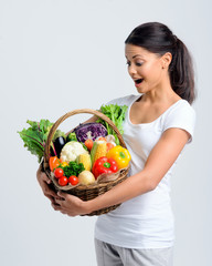 Woman surprised at her healthy basket of vegetables