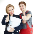 Apprentices for car mechanic and office have thumbs up