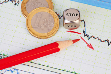 Downtrend financial chart, red pencil, red arrow, dices cube wit