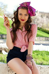 Young beautiful woman with ice cream outdoors