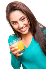 Beautiful mix race woman drinking juice