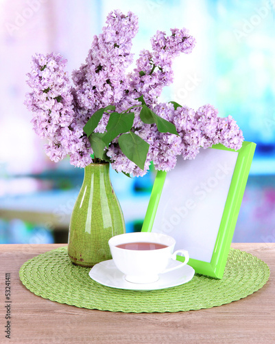 Beautiful lilac flowers on table in room