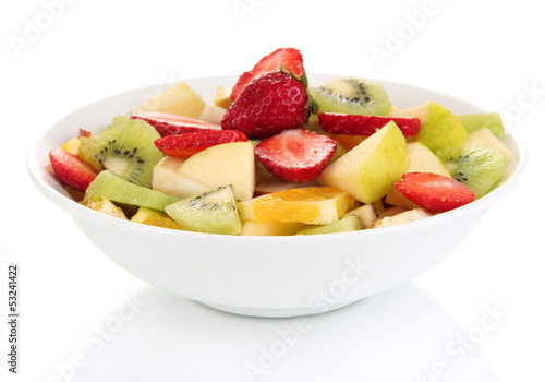 Useful fruit salad of fresh fruits and berries in bowl isolated