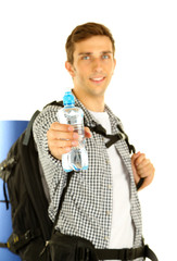 Young hiker man tourist holding bottle of water, isolated