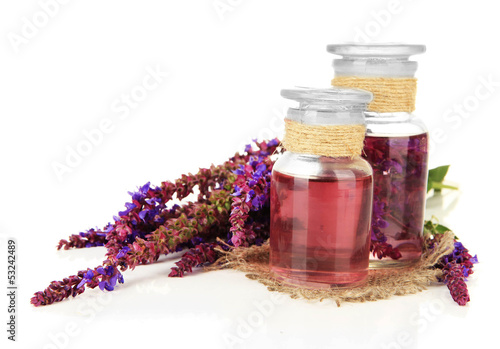 Medicine bottles with salvia flowers, isolated on white