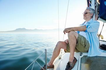 sitting on boat man
