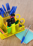 Office equipment in yellow stationary holder