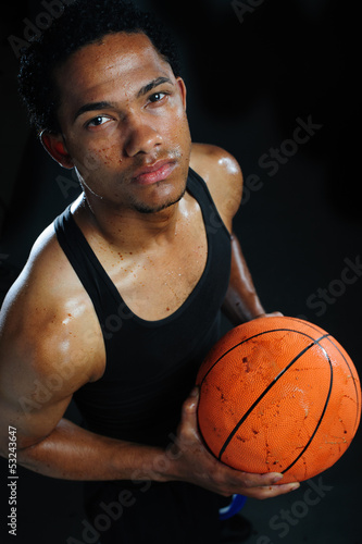 Portrait of a basketball. Ball is dirty from mud. He's sweating