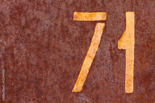 rusty background with number seventy one