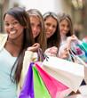 Shopping women in a row