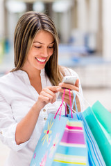 Shopping woman using smart phone