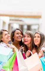 Shopping women looking up