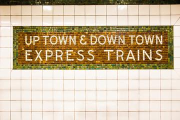 Tiled New York City subway train sign