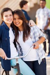 two teen girls friends hugging