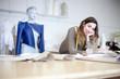 Fashion designer working on designs in the studio