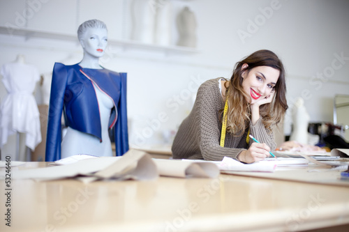 Fashion designer working on designs in the studio