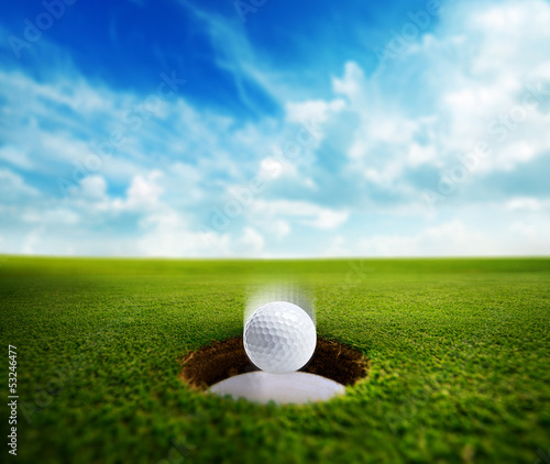 Golf Ball falling into hole