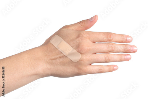Woman hand with a band aid