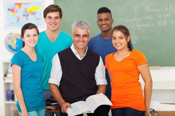 high school students in classroom with senior teacher