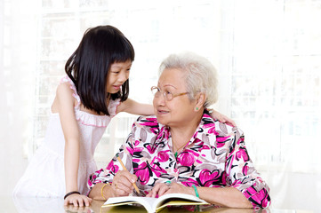 Asian senior woman and her granddaughter