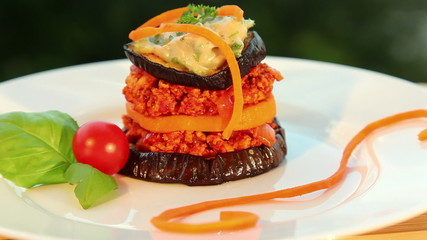 Vegan moussaka: tofu eggplant sweet potato tomato - dolly shot