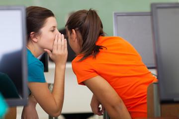 high school girls gossiping in class