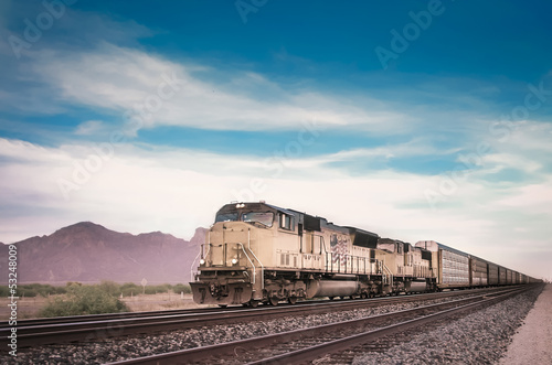 Freight train in Arizona desert landscape
