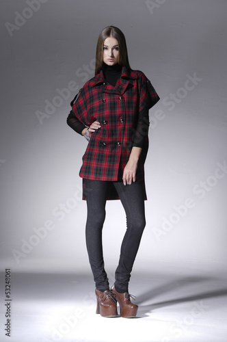 pretty girl in casual style clothing on light background