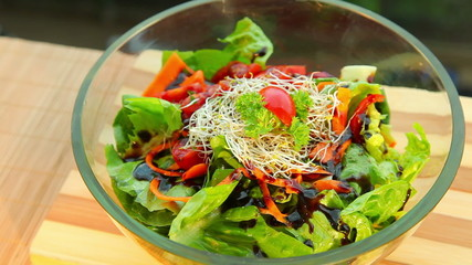 Fresh vegetable salad with dressing - dolly shot