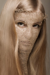 blond woman with gunny mask