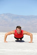 Fitness man crossfit training push-ups in desert