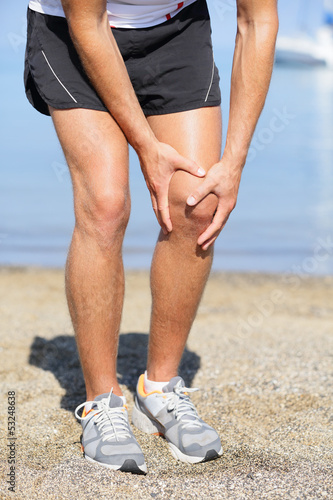 Running injury - Man out jogging with knee pain