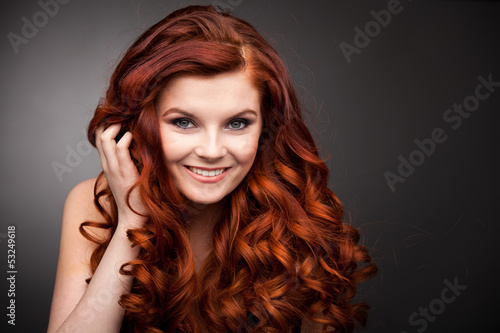 Glamour woman with long red