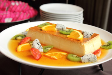Delicious creme caramel dessert with fruit