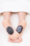 Hot stone reflexology feet massage