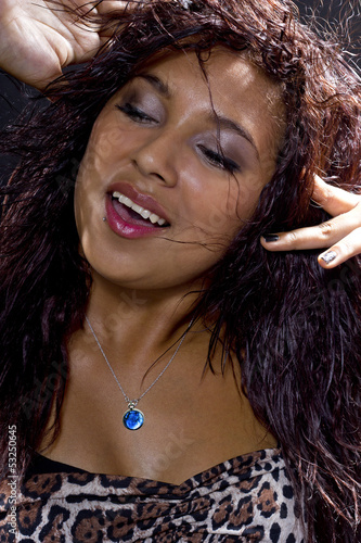 Close up of Hispanic woman partying