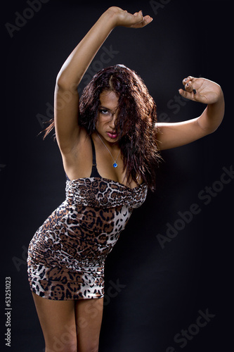 Latina woman clubbing/partying and wearing cheetah print