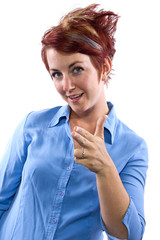 young redhead woman pointing at viewer