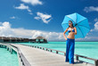 Woman on a beach jetty at Maldives