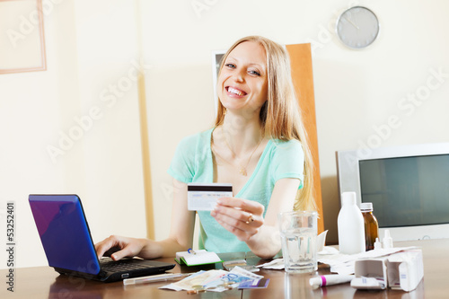 woman buying drugs online with laptop and  card