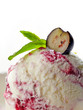 closeup of blueberry ice cream decorated with mint and berry