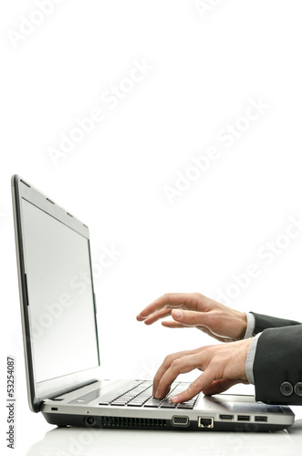 Typing on laptop