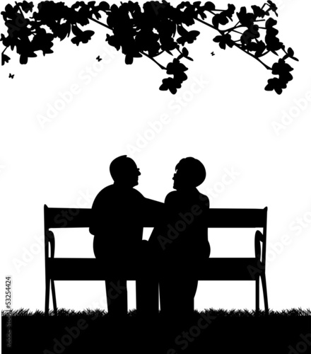 Lovely retired elderly couple sitting on bench in yard